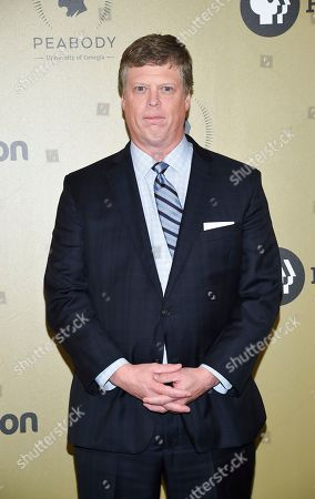 Stock Picture of George Foster Peabody Awards director Dr. Jeffrey P. Jones poses in the press room at the 76th Annual Peabody Awards at Cipriani Wall Street, in New York