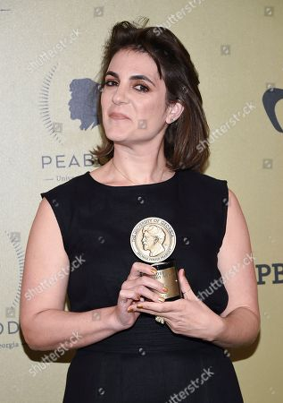 """Director and producer Jessica Edwards poses in the press room with the award for HBO's """"Mavis!"""" at the 76th Annual Peabody Awards at Cipriani Wall Street, in New York"""