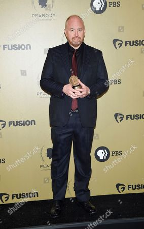 "Stock Photo of Executive producer Louis CK poses with the award for ""Horace and Pete"" at the 76th Annual Peabody Awards at Cipriani Wall Street, in New York. Photo by Evan Agostini/Invision/AP"