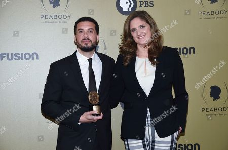 """Stock Picture of Director Ezra Edelman, left, and producer Caroline Waterlow pose with their award for """"O.J.: Made in America"""" at the 76th Annual Peabody Awards at Cipriani Wall Street, in New York"""