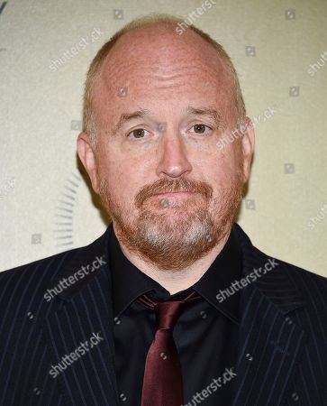 Louis CK poses in the press room at the 76th Annual Peabody Awards at Cipriani Wall Street, in New York