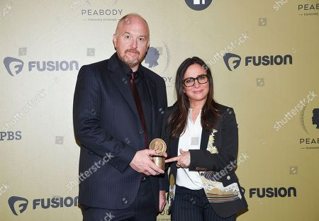 "Louis CK, left, and Pamela Adlon pose in with award for ""Better Things"" at the 76th Annual Peabody Awards at Cipriani Wall Street, in New York"
