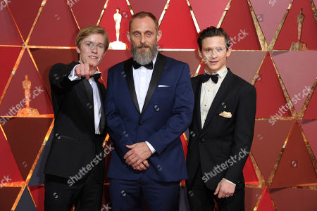 Louis Hoffman, from left, Roland Moller and Joel Basman arrive at the Oscars, at the Dolby Theatre in Los Angeles
