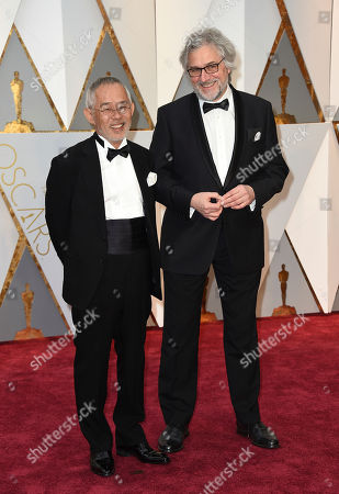 Stock Picture of Toshio Suzuki, left, and Michael Dudok de Wit arrive at the Oscars, at the Dolby Theatre in Los Angeles