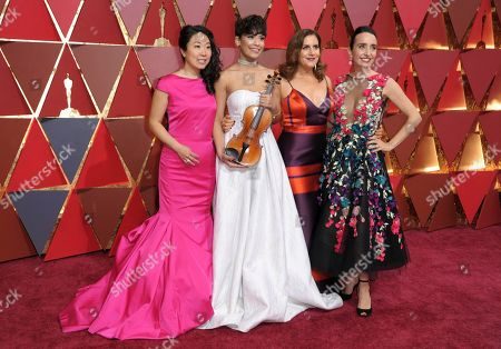 Kokoe Tanaka-Suwan, from left, Brianna Perez, Kahane Cooperman, and Raphaela Neihausen arrive at the Oscars, at the Dolby Theatre in Los Angeles