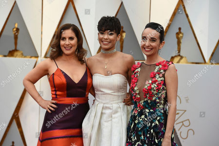Kahane Cooperman, from left, Brianna Perez and Raphaela Neihausen arrive at the Oscars, at the Dolby Theatre in Los Angeles
