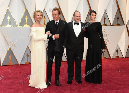 Trudie Styler, from left, Sting, J. Ralph, and Sarah Strayer arrive at the Oscars, at the Dolby Theatre in Los Angeles