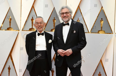 Stock Photo of Toshio Suzuki, left, and Michael Dudok de Wit arrive at the Oscars, at the Dolby Theatre in Los Angeles