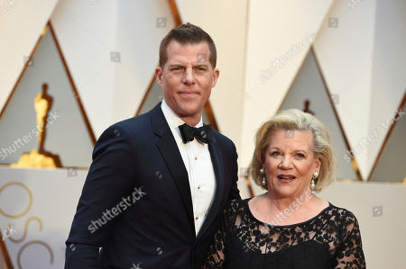 Kevin J. Walsh, left and guest arrive at the Oscars, at the Dolby Theatre in Los Angeles