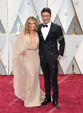 From left, Debbie Matenopoulos and Louis Aguirre arrive at the Oscars, at the Dolby Theatre in Los Angeles