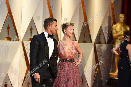 From left, Joe Machota and Scarlett Johansson arrive at the Oscars, at the Dolby Theatre in Los Angeles