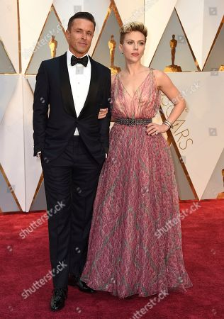 Joe Machota, left, and Scarlett Johansson arrive at the Oscars, at the Dolby Theatre in Los Angeles