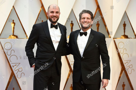 Jordan Horowitz, left and Gary Gilbert arrive at the Oscars, at the Dolby Theatre in Los Angeles