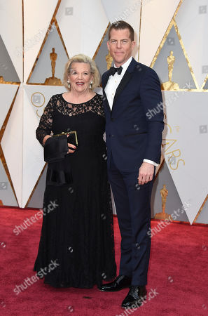 Kevin J. Walsh, right and guest arrive at the Oscars, at the Dolby Theatre in Los Angeles