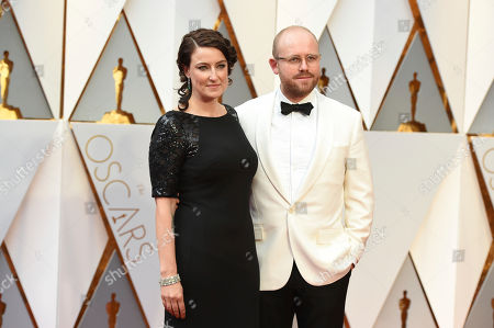Adele Aomanski, left, and James Laxton arrive at the Oscars, at the Dolby Theatre in Los Angeles