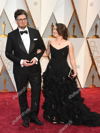Kristof Deak, left, and guest arrive at the Oscars, at the Dolby Theatre in Los Angeles