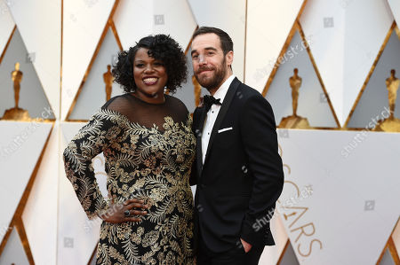 Joi McMillon, left, and Nat Sanders arrive at the Oscars, at the Dolby Theatre in Los Angeles