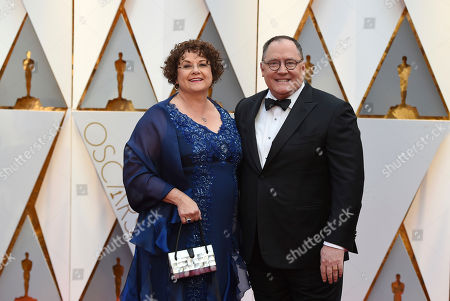 From left, Nancy Lasseter and John Lasseter arrive at the Oscars, at the Dolby Theatre in Los Angeles