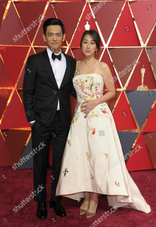John Cho, left, and Kerri Higuchi arrive at the Oscars, at the Dolby Theatre in Los Angeles