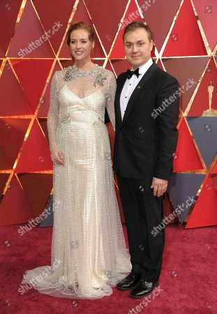 Kimberly Quinn, left, and Theodore Melfi arrive at the Oscars, at the Dolby Theatre in Los Angeles