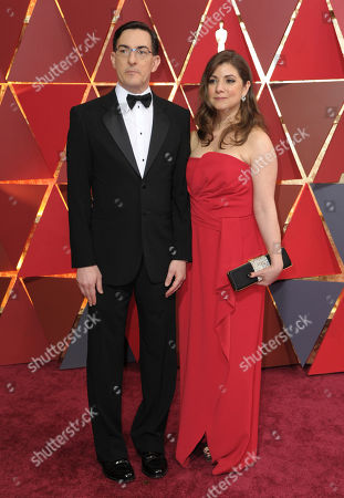 Eric Heisserer, left, and Christine Boylan arrive at the Oscars, at the Dolby Theatre in Los Angeles