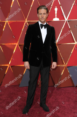 Luke Bracey arrives at the Oscars, at the Dolby Theatre in Los Angeles