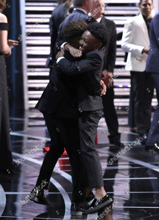 """Jaden Piner and Alex R Hibbert embrace as """"Moonlight"""" wins the best picture award at the Oscars, at the Dolby Theatre in Los Angeles"""