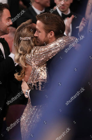 Ryan Gosling, right, embraces sister Mandi Gosling at the Oscars, at the Dolby Theatre in Los Angeles