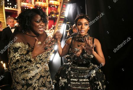 "Joi McMillon, left, and Janelle Monae appear offstage after ""Moonlight"" wins best picture award at the Oscars, at the Dolby Theatre in Los Angeles"