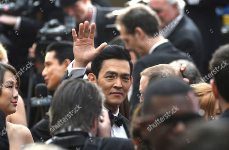 Kerri Higuchi, left, and John Cho arrive at the Oscars, at the Dolby Theatre in Los Angeles