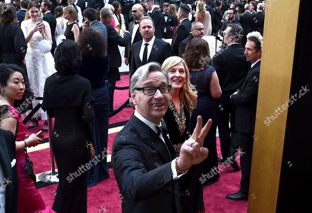 Paul Feig, from left, Laurie Karon arrive at the Oscars, at the Dolby Theatre in Los Angeles