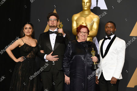 "Kristof Deak, center left, and Anna Udvardy, center right, winners of the award for best live-action short film for ""Sing,"" pose in the press room with Salma Hayek, left, and David Oyelowo at the Oscars, at the Dolby Theatre in Los Angeles"