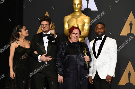 "Kristof Deak, second from left, and Anna Udvardy, winners of the award for best live-action short film for ""Sing"", pose in the press room with Salma Hayek, left, David Oyelowo, right, at the Oscars, at the Dolby Theatre in Los Angeles"