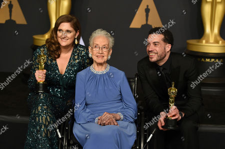 Caroline Waterlow, from left, Katherine Johnson, Ezra Edelman pose in the press room at the Oscars, at the Dolby Theatre in Los Angeles