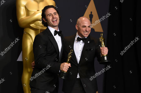 Alan Barillaro, left, and Marc Sondheimer pose in the press room at the Oscars, at the Dolby Theatre in Los Angeles