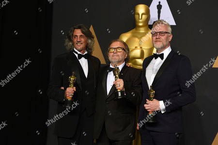 Giorgio Gregorini, from left, Alessandro Bertolazzi, and Christopher Nelson pose in the press room at the Oscars, at the Dolby Theatre in Los Angeles
