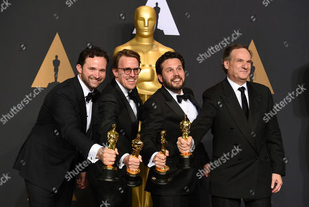 """Dan Lemmon, from left, Andrew R. Jones, Adam Valdez and Robert Legato pose in the press room with the award for best visual effects for """"The Jungle Book"""" at the Oscars, at the Dolby Theatre in Los Angeles"""