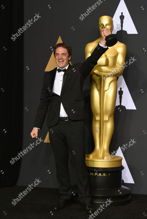 Sylvain Bellemare poses in the press room at the Oscars, at the Dolby Theatre in Los Angeles