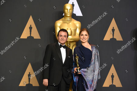 Dr. Firouz Naderi, left, and Anousheh Ansari pose in the press room at the Oscars, at the Dolby Theatre in Los Angeles