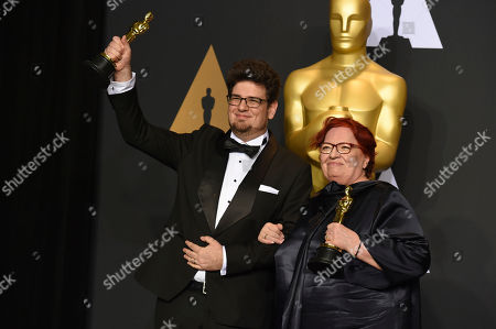 "Stock Photo of Kristof Deak, left, and Anna Udvardy, winners of the award for best live-action short film for ""Sing"", pose in the press room at the Oscars, at the Dolby Theatre in Los Angeles"