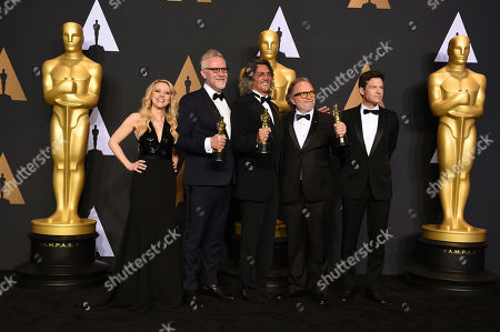 """Christopher Nelson, second from left, Giorgio Giorgio, center, and Alessandro Bertolazzi, second from right, winners of the award for best makeup and hairstyling for """"Suicide Squad"""" pose in the press room with Kate McKinnon, left, and Jason Bateman, right, in the press room at the Oscars, at the Dolby Theatre in Los Angeles"""