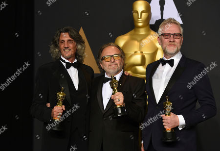 Giorgio Gregorini, from left, Alessandro Bertolazzi and Christopher Nelson pose in the press room at the Oscars, at the Dolby Theatre in Los Angeles