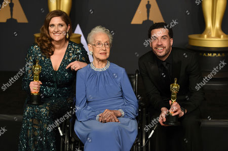 Caroline Waterlow, from left, Katherine Johnson, and Ezra Edelman pose in the press room at the Oscars, at the Dolby Theatre in Los Angeles