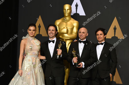 """Alan Barillaro, second from left, and Marc Sondheimer, winners of the award for best animated short film for """"Piper"""", pose in the press room with Hailee Steinfeld, left, and Gael Garcia Bernal, right, at the Oscars, at the Dolby Theatre in Los Angeles"""