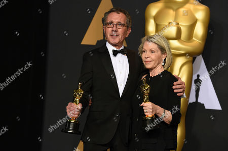 """David Wasco, left, and Sandy Reynolds-Wasco, winners of the award for best production design for """"La La Land"""", pose in the press room at the Oscars, at the Dolby Theatre in Los Angeles"""