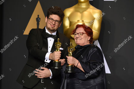 """Kristof Deak, left, and Anna Udvardy, winners of the award for best live-action short film for """"Sing,"""" pose in the press room at the Oscars, at the Dolby Theatre in Los Angeles"""