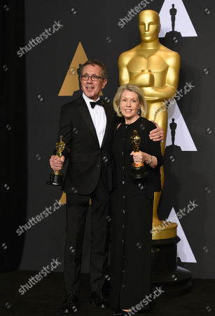 """David Wasco, left, and Sandy Reynolds-Wasco, winners of the award for best production design for """"La La Land,"""" pose in the press room at the Oscars, at the Dolby Theatre in Los Angeles"""