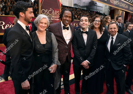 Walter Suskind, from left, Cornelia Suskind, Roger Ross Williams, Owen Suskind, Julie Goldman, and Ron Suskind arrive at the Oscars, at the Dolby Theatre in Los Angeles