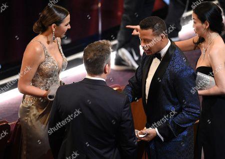 Luciana Barroso, from left, Matt Damon, Terrence Howard, and Miranda Pak at the Oscars, at the Dolby Theatre in Los Angeles