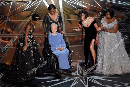 """Janelle Monae, left, Taraji P. Henson, second right and Octavia Spencer, right, introduce Katherine Johnson, seated, the inspiration for """"Hidden Figures,"""" as they present the award for best documentary feature at the Oscars, at the Dolby Theatre in Los Angeles"""